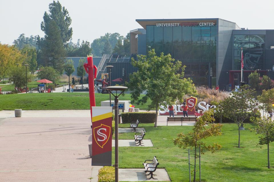 Male walking looking at phone